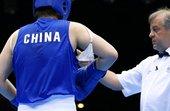 当地时间2012年8月5日,伦敦奥运会女子拳击75公斤级1/8决赛,李金子19-14费托萨。比赛中李...
