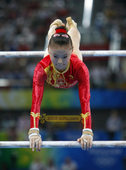 2012伦敦奥运临近之际,搜狐体育将回顾中国代表团在北京奥运会上夺下的51枚金牌。当日,在体操高低杠...