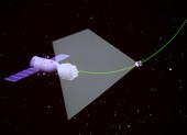 9月27日,在完成航天员出舱任务后,神舟七号飞船在太空释放一颗伴飞小卫星(摄于北京航天飞行控制中心大...