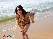 2010年11月2日,舞时尚亚运沙排宝贝三亚写真,蓝天碧水秀迷人身段。
